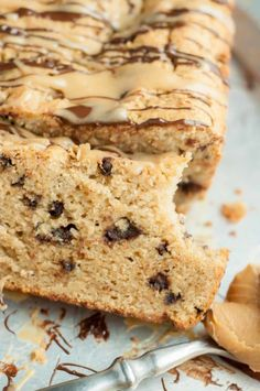 Peanut Butter Chocolate Chip Quick bread is a recipe everyone will be begging you for! This moist bread is drizzled with peanut butter and chocolate glazes. http://www.mamagourmand.com