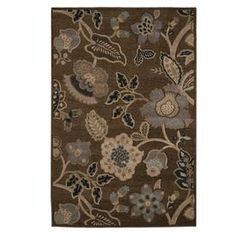 Make a statement in any room with this area rug in brown, tan and blue.