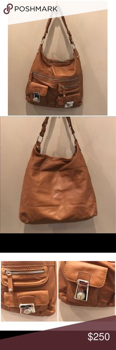 """Tod's Multipocket Leather Hobo Light creasing and scuffs throughout exterior and shoulder strap. Light surface scratches on hardware. Minor marks throughout interior.  Size Width (at base): 14.5"""" Height: 14.5"""" Depth: 1"""" Shoulder Strap Drop: 16.5""""  Product Details Type of Material: Leather Color: Tan Lining: Tan fine textile Pockets: Two front zip, Two front push lock, Interior Zip Hardware: Light Gold Tone Closure: Zipper Origin: Italy Includes: Dust bag Tod's Bags Hobos"""