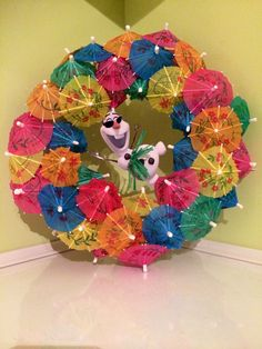 Olaf in summer wreath made of foam ring covered in tiny umbrellas.