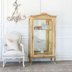 Gilt vitrine with distressing and natural wood showing through. Shell carving at top crest and floral carvings on serpentine feet. Gilt hardware, two glass shelves, and a beveled mirror on inside. Types Of Furniture, New Furniture, Furniture Making, Wine Glass Shelf, Glass Shelves In Bathroom, Living Room Cabinets, Living Room Shelves, Local Furniture Stores, Ikea