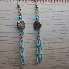 """Use the coupon code WEAREOPEN to save 10% on orders of $15 or more at checkout thru Sept 30th for our GRAND OPENING!.....  Stainless steel plated hooks, light blue """"E"""" beads, engraved stainless steel plated disc & blue and white plastic coated chain dangles"""