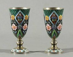: PAIR OF ANTIQUE RUSSIAN SHADED CLOISONNE ENAMEL SILVER VODKA CUPS. CIRCA 1908-1926 Decorated with polychrome cloisonne enamel features pink and purple iries.
