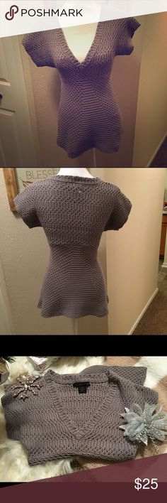 """Calvin Klein tunic sweater I adore this sweater!!! I wish it fit me 😭😭😭 anyway it is a grey/taupe color. Crocheted so needs a cami underneath, and that V does go low. Has a very cute """"flare out"""" effect at the waist. Love love love this, scoop it up today! Calvin Klein Tops"""