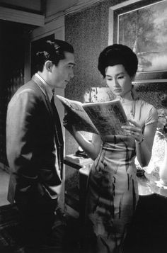 """FA YEUNG NIN WA""_""IN THE MOOD FOR LOVE"" (2000)  Photos with Maggie Cheung, Tony Leung Chiu Wai.A man and a woman move in to neighboring Hong Kong apartments and form a bond when they both suspect their spouses of extra-marital activities.         Director:   Kar Wai Wong"