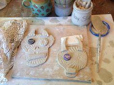 Ceramic skulls by Jodie Flowers.