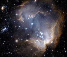 NGC 602 and Beyond   Credit: NASA, ESA, and the Hubble Heritage Team (STScI / AURA) - ESA/Hubble Collaboration