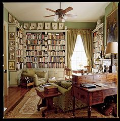 Oh, I drool and swoon over a library room like this.  Perhaps I could redesign my living room...
