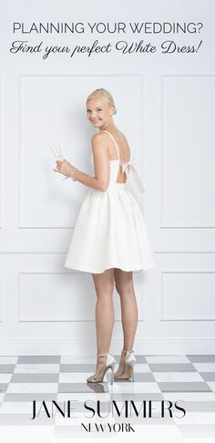 With an elegant Blush Pink ribbon gracefully tied at the open back, this short white dress with straps and a modest above knee length transitions perfectly from a formal Engagement Party dress to a casual Bridesmaid Luncheon outfit.  Whether a Spring, Summer or early Fall wedding, this sophisticated and romantic backless short white dress with modern couture inspired style ensures you will be fashion right for your wedding parties. Shop our designer short white dress collection…