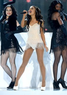 Ariana Grande Photos Photos - Singer Ariana Grande performs onstage during the 2015 American Music Awards at Microsoft Theater on November 22, 2015 in Los Angeles, California. - 2015 American Music Awards - Show
