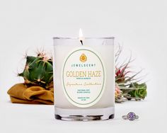 Signature Golden Haze Candle -  Rich vanilla bean notes blend with the warmth of sandalwood in this musky, deep scent. Black Pepper and Coriander add just a touch of spice to an aroma as soothing as the southwestern evening skies for $23.99 at JewelScent.com/kaylasanchez