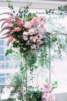 Cecilia Fox wedding flower arch derail with blush pink and dusky purple xx