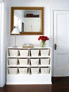 shelf with baskets - I LOVE this idea. very clean and simple, but could hold a lot of random things that are always sitting around... :P