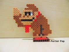 Super Mario Maker Donkey Kong perler beads by Perler-Pop Pearler Beads, Fuse Beads, Super Mario, Yoshi, Mario And Luigi, Mario Bros, Perler Bead Art, Donkey Kong, Perler Patterns