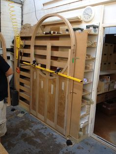 setting up oak shutters in the workshop