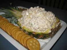 Pineapple Cheese Spread   2- 8 oz. pkgs cream cheese, softened 1- 15 oz. can crushed pineapple, well drained 1/4 C. finely chopped green pepper 2 T. finely chopped onion 1 T. seasoned salt (or less) 2 C. finely chopped pecans  Combine and mix all ingredients together. Refrigerate several hours. Serve with crackers.
