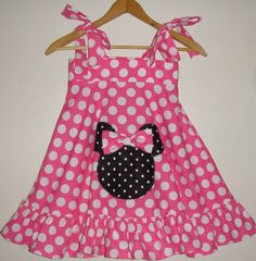 Appliqued Minnie Mouse Pink Ruffled twirl dress  polka dots   1 thru 4. $31.99, via Etsy.