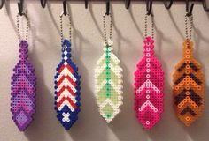 Feather Keychain made of Hama beads by PrebreakofdawnCrafts on Perler Bead Designs, Hama Beads Design, Diy Perler Beads, Perler Bead Art, Melty Bead Patterns, Pearler Bead Patterns, Perler Patterns, Beading Patterns, Peler Beads
