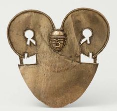 Colombia | A pectoral recovered from an archaeological site | Tumbaga ~  was the name given by Spaniards to a non-specific alloy of gold and copper which they found in widespread use in pre-Columbian Mesoamerica and South America.