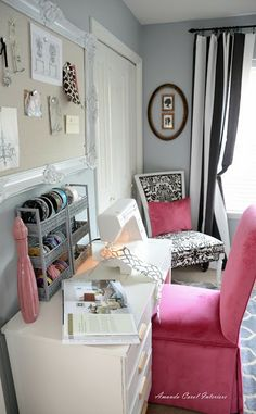 Interior designer and blogger Amanda Carol used Sherwin-Williams paint color Colonial Revival Gray (SW 2832) accented with pink, black and gold in her home office.