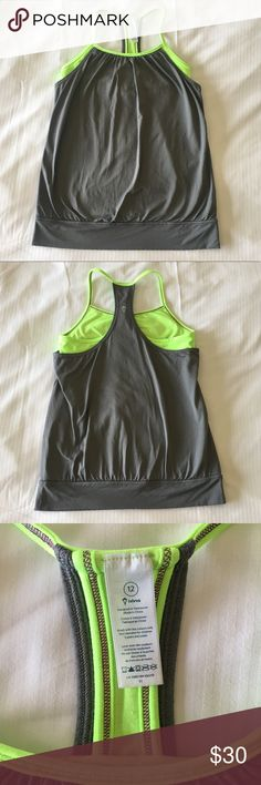 Ivivva Lululemon Girl's Double Dutch Tank Top 12 IVIVVA Girls Double Dutch Tank Gray Citrine Green Lululemon - double layer tank offers you coverage -top layer in mesh fabric is lightweight and sweat–wicking. added Lycra fibre for serious stretch and long–term.  Coolmax liner wicks sweat away from your body, pockets for sport bra inserts for extra coverage, racerback shape allows for full range of movement, bottom hem band helps keep your tank in place  size 12  excellent pre-owned condition…