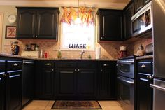 French Country Kitchen redo, oak cabinets painted black as a DIY project. Kitchen Cabinets Pictures, Country Kitchen Cabinets, Country Kitchen Designs, Kitchen Redo, New Kitchen, Kitchen Remodel, Kitchen Dining, Kitchen Ideas, Black Kitchens