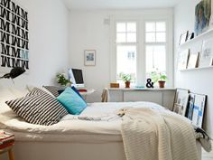 narrow-bedroom-design-scandinavian-style-white-interior-with-sticker-wall-and-computer-desk-near-windows