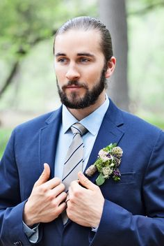 Navy Blue Suit + Rustic Boutonniere | Photo: Lucky Love Photography.