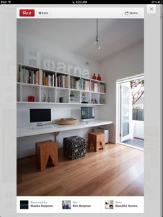 Study space. Love the desk and storage on wall.