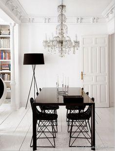Crystal chandelier and black lamp La Jolla house add black doors