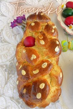 Tsoureki, plural Tsourekia, (pronounced TSOU-rhe-kee), is a slightly sweet Greek bread, similar to brioche, which is braided and made throughout the year. It is also part of our Easter and Christmas traditions. #tsoureki #sweetbread #Easterbread Pizza Croissant, Brunch Recipes, Dessert Recipes, Greek Bread, Greek Easter, Brioche Bread, Types Of Desserts, Breakfast Pizza, Baking Tins