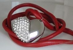 Fashionable NEW Swarovski heart shape USB (2GB) The Scandinavian piece of design is made with popular stitched lambskin leather cord (4mm).