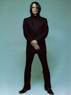 Sakurai Atsushi - Buck-Tick, vocals. His penchant for black, greys, almost black, russets, etc. is cause for serious appreciation.