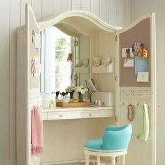 armoire upcycled as bedroom vanity - great way to hide away a messy vanity top