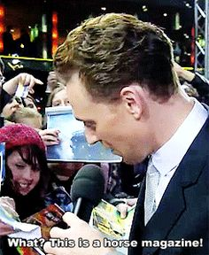 (gifset) This is legendary! - someone brilliant handed him a Horse Magazine to sign! ehehehe ~ SOMEONE LOKI'D TOM!