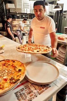 Pizzaiolo getting the pizza ready | L'Osteria | Pizza E Pasta