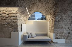 Image 44 of 71 from gallery of Old Jaffa House 4 / Pitsou Kedem Architects. Photograph by Amit Geron Metal Cladding, Wall Cladding, Modern Lighting, Lighting Design, Old Jaffa, Pitsou Kedem, Ancient Buildings, Outdoor Chairs, Outdoor Decor