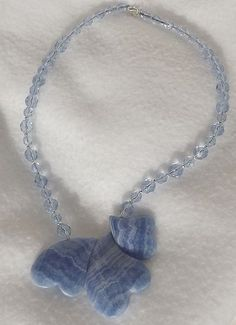 """$20.00 - Ice blue faceted glass beads mixed with a tad of silver tone spacers. The focal hearts are blue Italian """"onyx"""" which looks similar to blue lace agate, 17 inch long"""