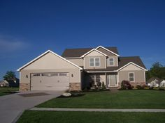First floor master, 4 bedroom home. Exterior features shake, stone, and vertical siding.