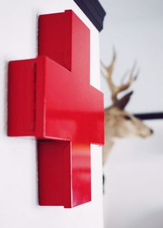Red cross: would be neat for a first-aid cabinet. Though I might be inclined to paint it black instead..