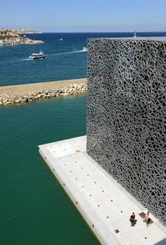"The Museum of European and Mediterranean Civilisations (MuCEM)  is a national museum located in Marseille, in the South of France. The museum built ""of stone, water and wind"" was designed by the architect Rudy Ricciotti in collaboration with the architect Roland Carta. A cube of 15,000 square metres surrounded by a latticework shell of fibre-reinforced concrete."