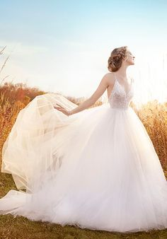 Tulle ball gown wedding dress with V-neckline and sequined embroidered bodice I Style: 8610 I by Jim Hjelm I http://knot.ly/6495811av