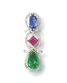 A diamond and gem-set pendant. The pendant formed as an articulated line of a cushion-cut sapphire, a square step-cut ruby and a pear-cut emerald, each within an openwork surround of round brilliant-cut diamonds connected by V-shaped diamond-set spacers, mounted in 18k white and yellow gold, pendant length 3.6cm