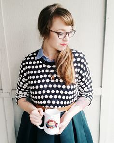 Kelsey of Honey and the Hive dressed head to toe in Ruche wear while sipping tea from one of her handmade mugs.