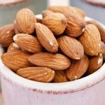 Almonds Why they're a flat belly food: A 2003 study found that dieters who ate 3 ounces of almonds a day lost more weight and had smaller waists than dieters who ate similarly but swapped almonds for complex carbohydrates. Packed with MUFAs, almonds can be added to cereal, sprinkled on salads, or grabbed by the handful (just one!) as a belly-shrinking snack.