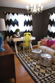 Black & white chevron striped curtains, yellow chair, silver poof