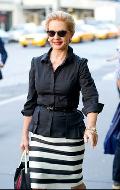 Carolina. Horizontal striped pencil skirt. Black blouse, not tucked in. belted. Sleeves rolled up. All sleek and modern. Love it!