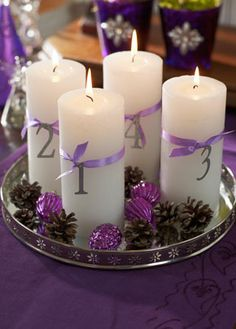I like this as an idea for table numbers at my wedding!! Witout the pinecones and fake purple pinecone lookin things.. lol