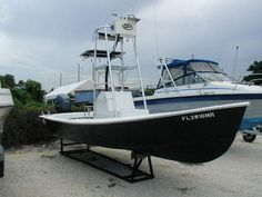Navy on the lift Fishing Rigs, Fishing Charters, Sport Fishing, Fishing Boats, Mako Boats, Water Time, Center Console Boats, Wooden Boat Plans, Aluminum Boat