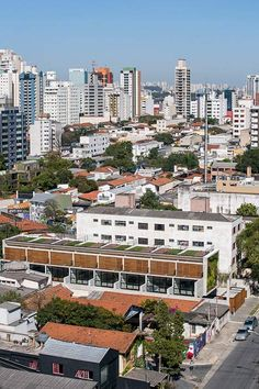 Wall of bushy plants fronts Sao Paulo housing block by TACOA